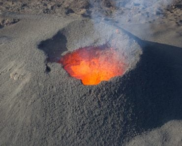 Magma as it nears the rim of the crater of a volcano.