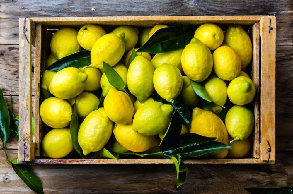 Organic lemons on a wooden crate.