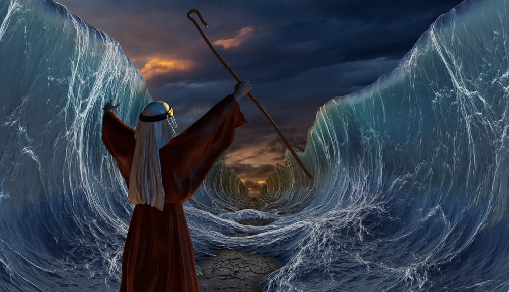 Illustration of Moses as he commands the Red Sea to part.
