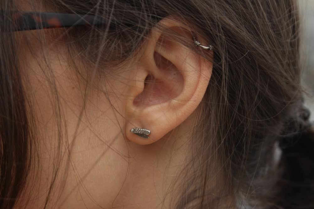 Closeup of a stud earring.