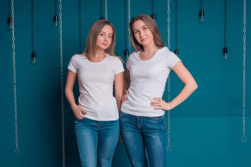 Two brunettes wearing a plain white t-shirt.