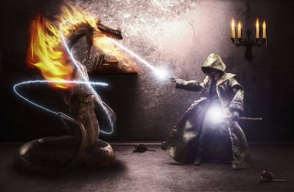 A wizard is using his powers to defeat a dragon.