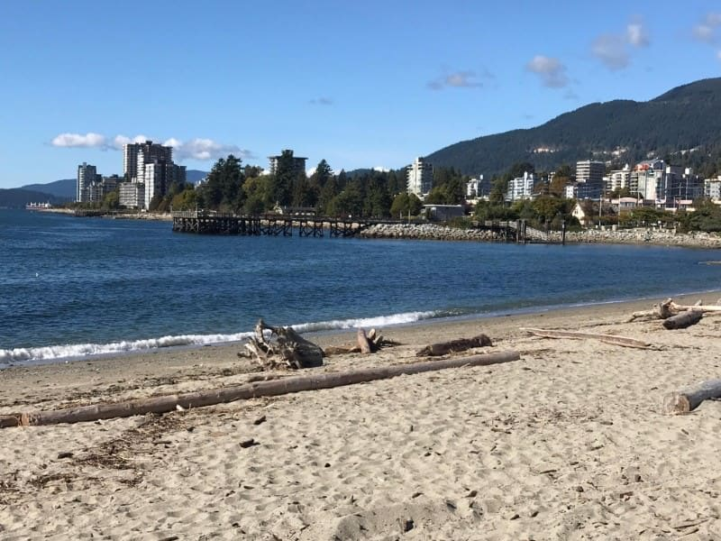 View of the pier at Ambleside Beach in West Vancouver, BC