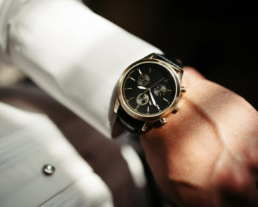 Elegant analog dress watch on fomrally dressed man
