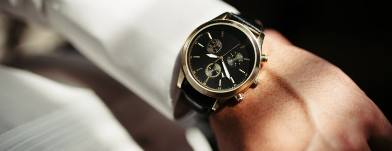 Elegant analog dress watch on fomrally dressed man
