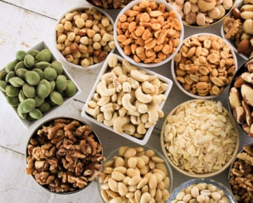 Table with a variety of nuts in bowls