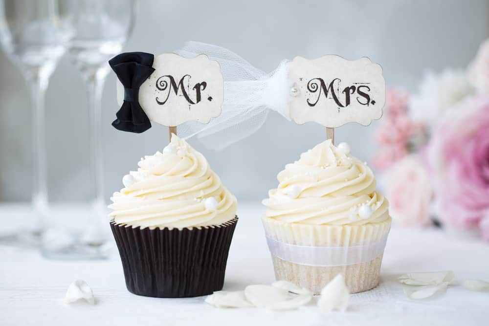 Mr. and Mrs. cupkaes on a wedding table.