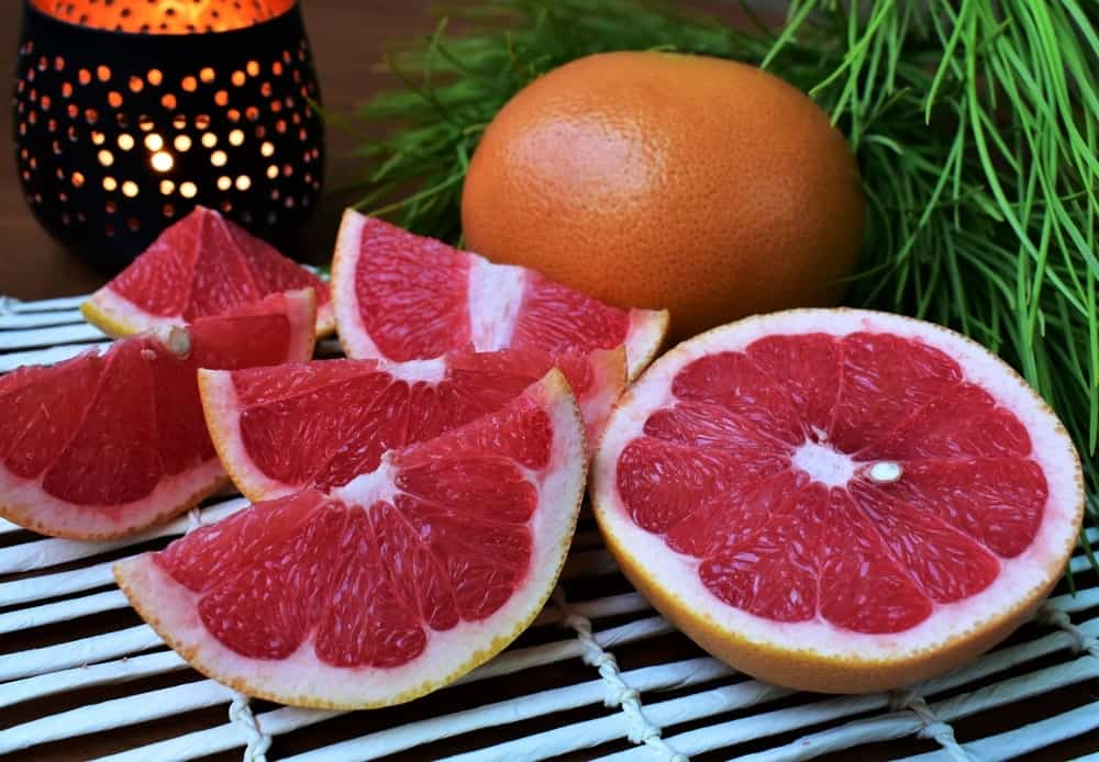 Whole and slices of flame grapefruit.