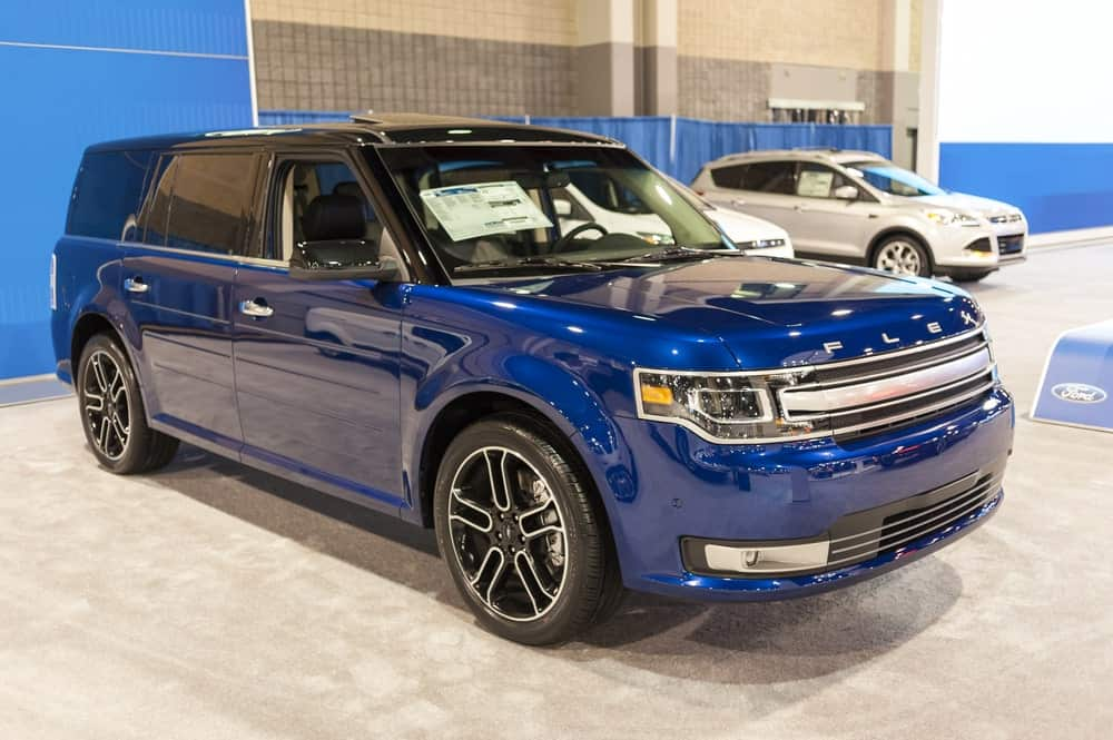 Blue Ford Flex at a showroom.