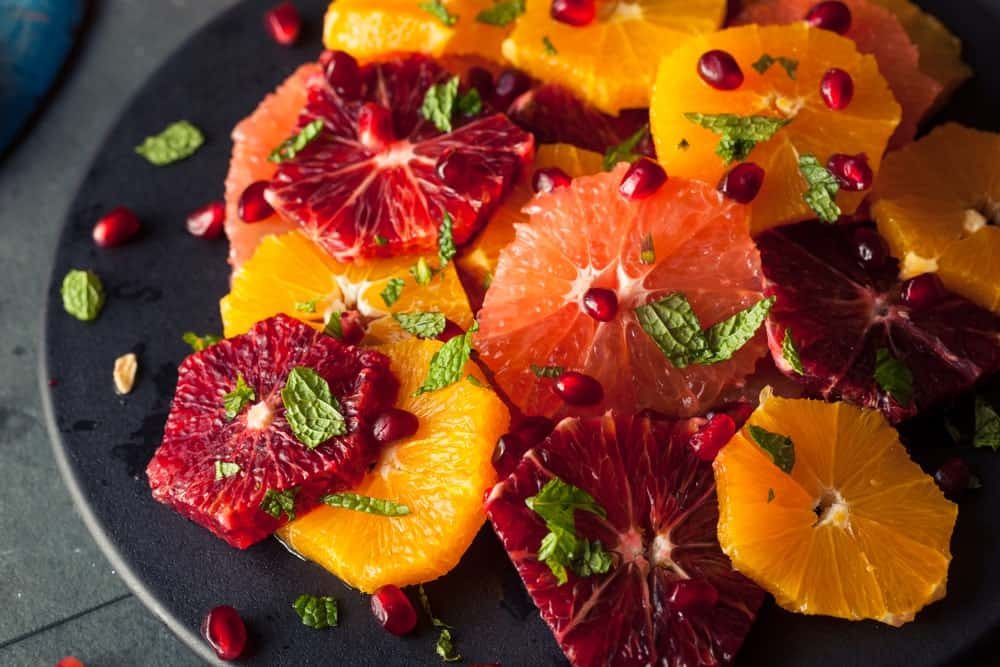 A plate of grapefruit and citrus salad.