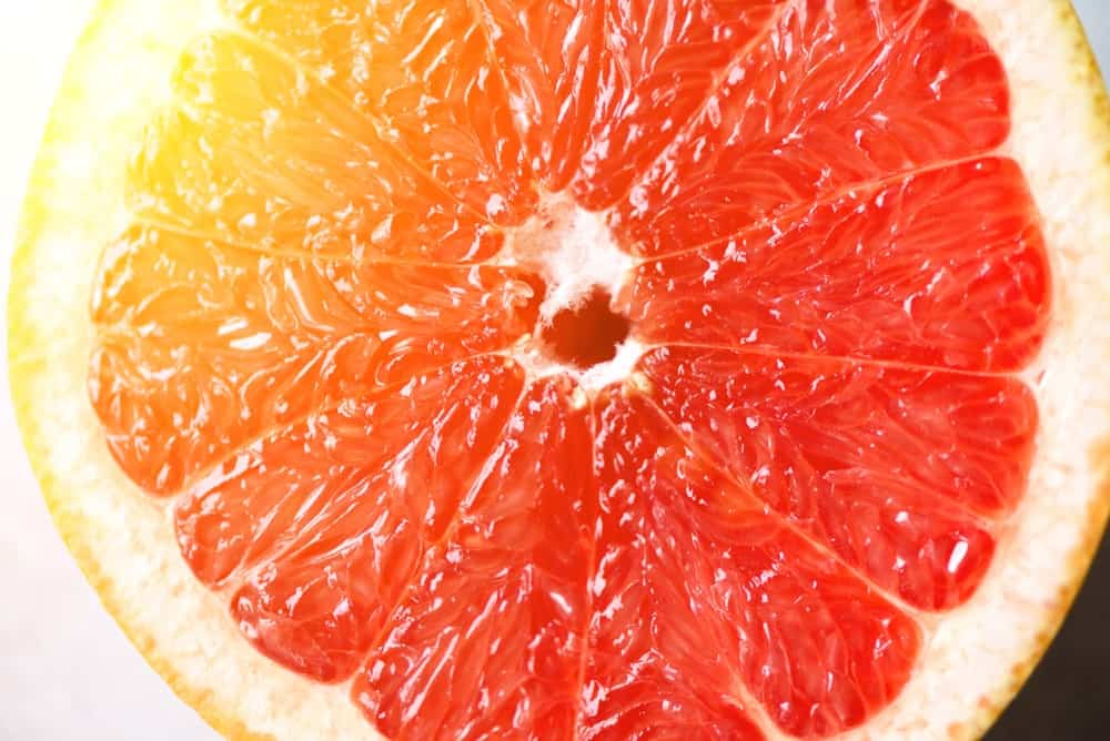Closeup of a slice of grapefruit.