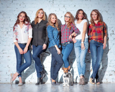 group of women wearing blue jeans