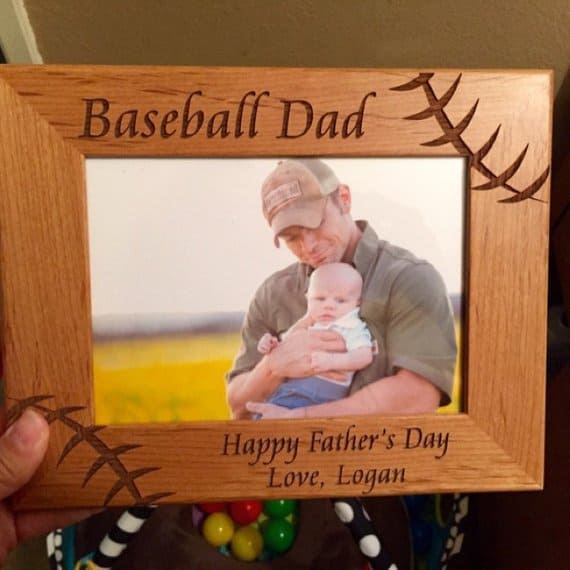 Handmade picture frame with a photo of a father and baby son.