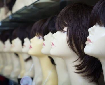 A row of wigs