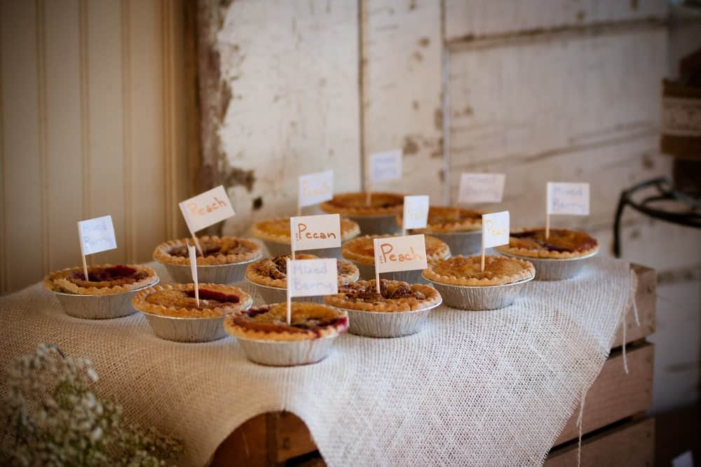 Pies on a decorated table during a wedding ceremony.