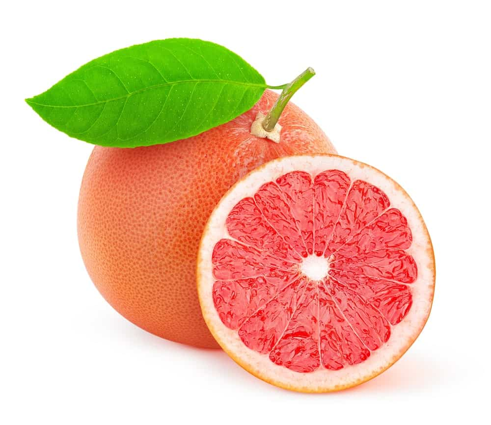 A whole and a half slice of pink grapefruit on white background.