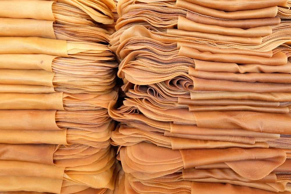 Stacks of natural rubber sheets.