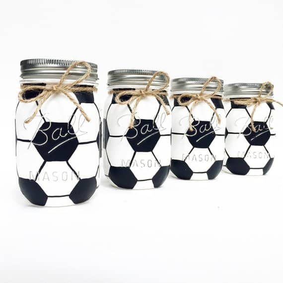 Soccer-themed mason jars lined up in a row.