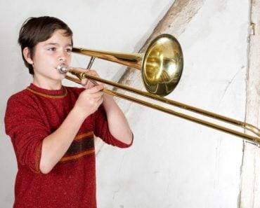 Boy playing a trombone