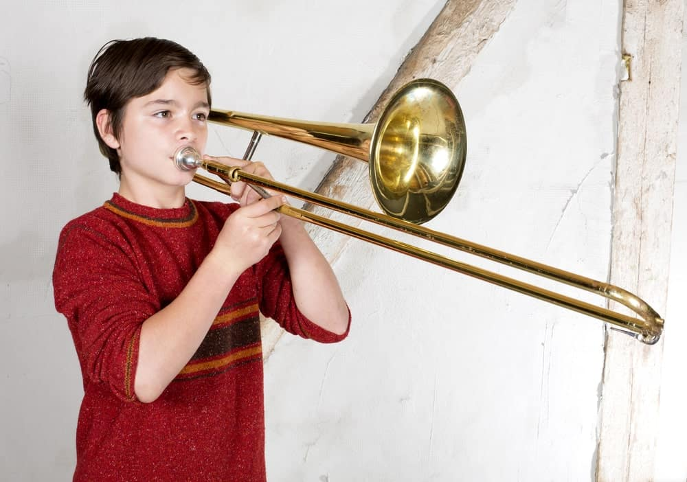 Boy playing a trombone