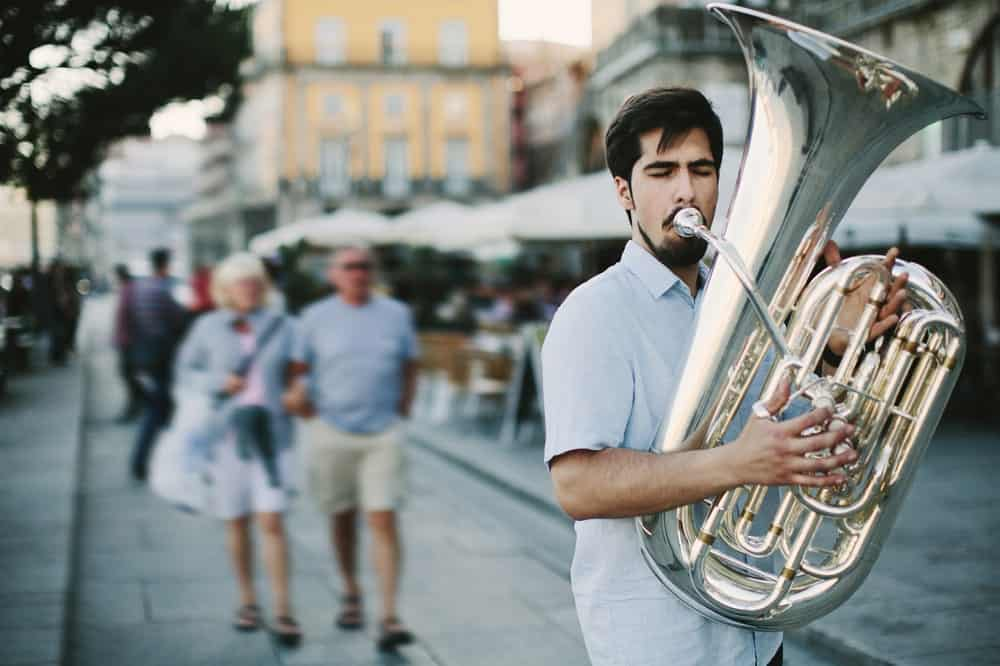 Street musician playing a tuba.