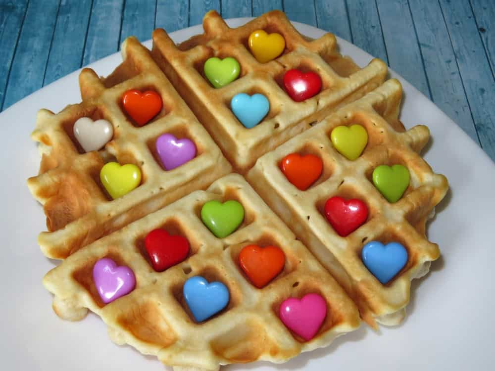 Waffle with colorful heart-shaped candies.