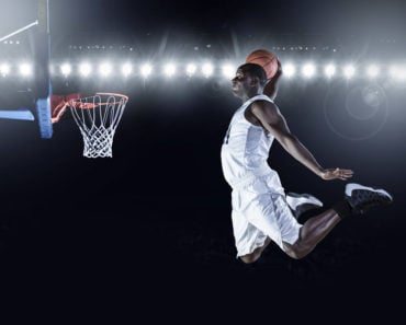 Basketball player slam dunking
