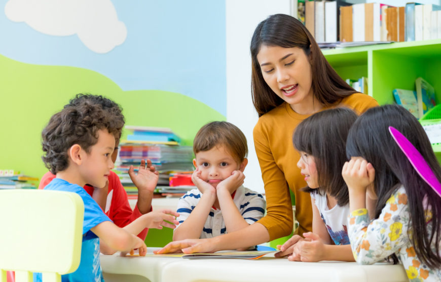 Daycare provider teaching young daycare students