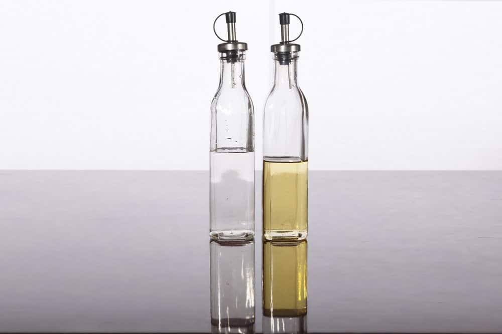 Two bottles of vinegar and linseed oil.