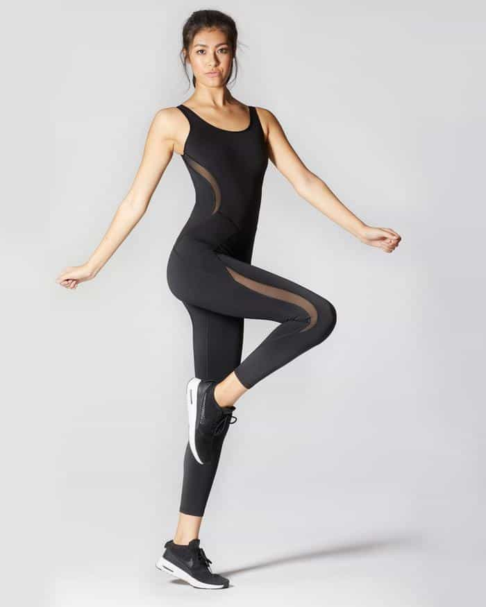 Woman striking a pose wearing a Michi Clothing activewear.