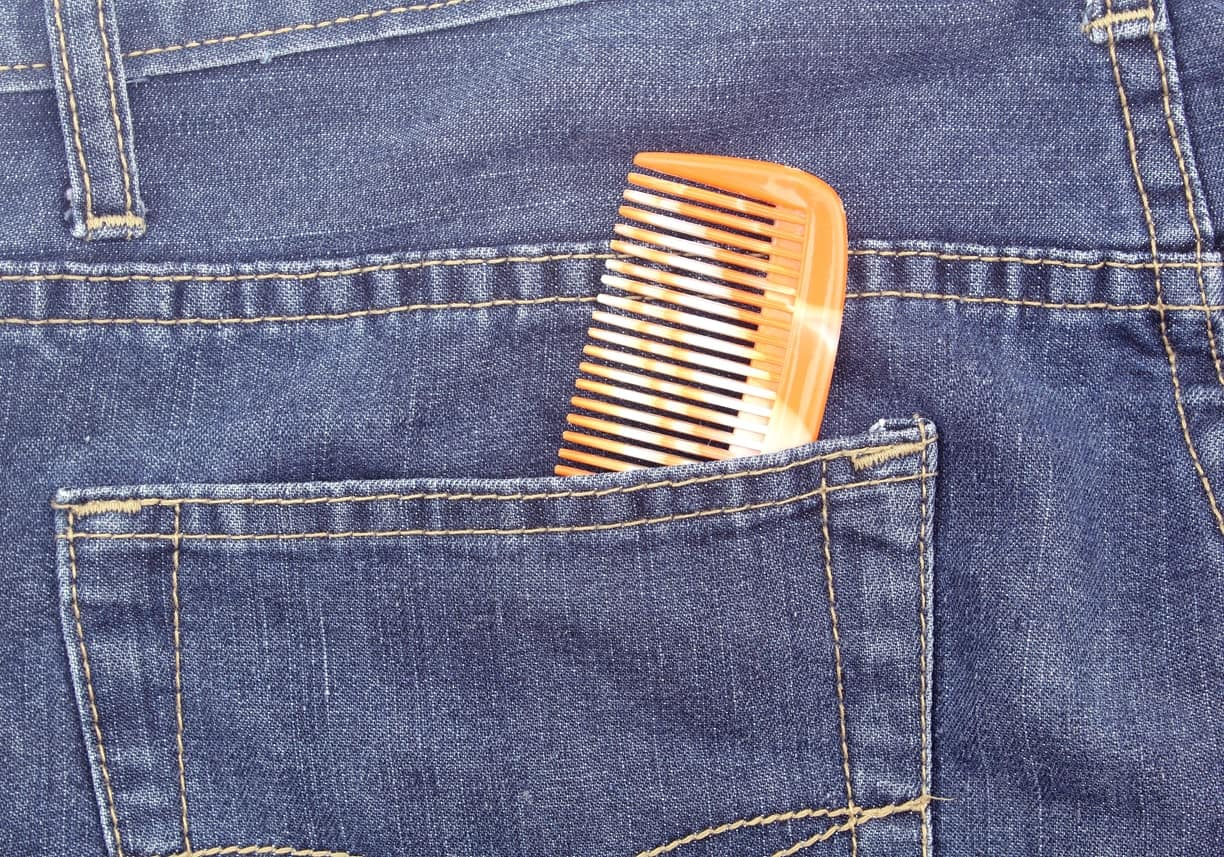 Pocket comb inside a jeans pocket.