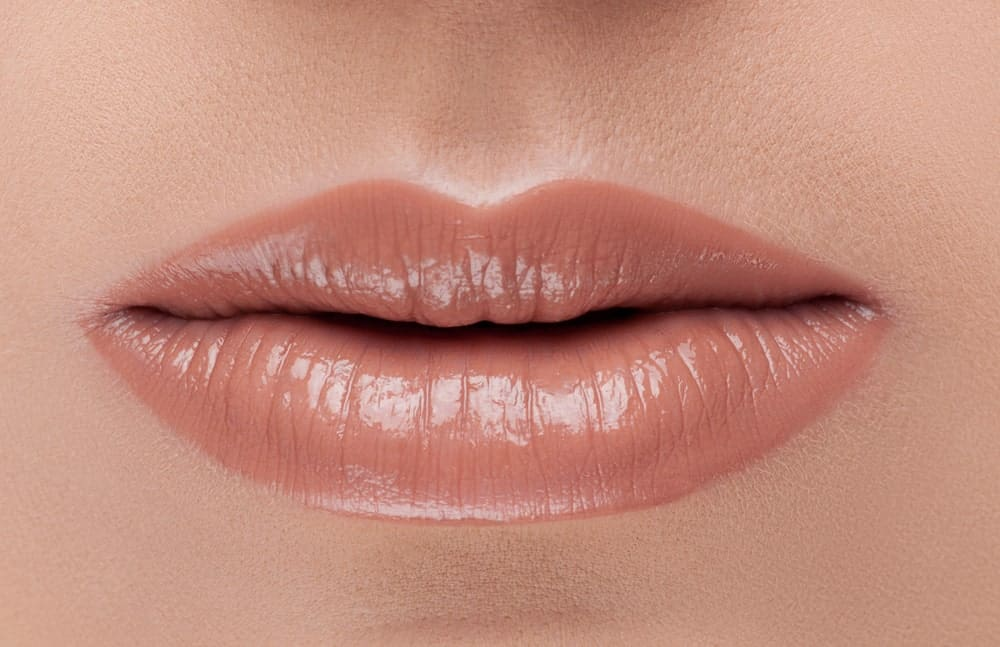 Closeup of sheer lipstick on the lips.