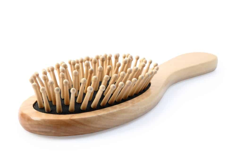 Wooden hairbrush with wooden bristles