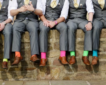 Group of men wearing colorful socks