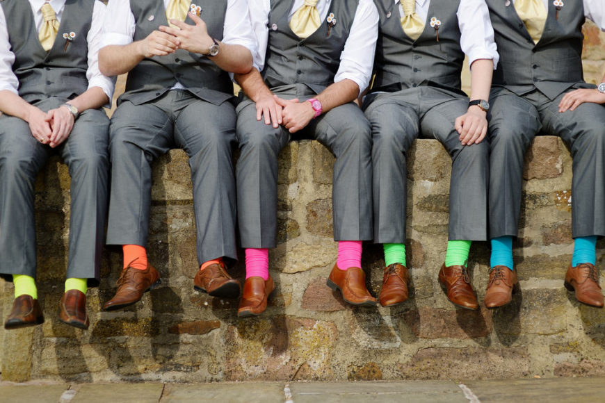 Group of men wearing colorful socks