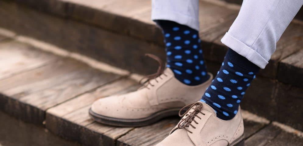 Man wearing dark and light blue socks