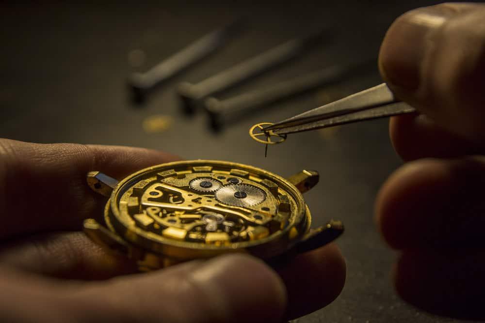 Watchmaker repairing an antique wristwatch