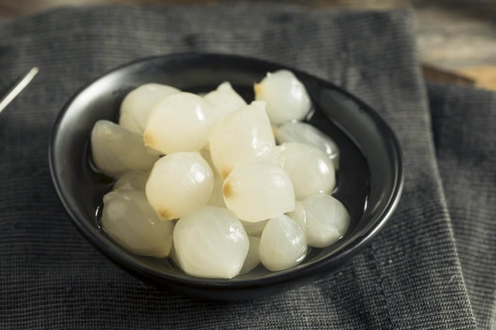A bowl of pickled cocktail onions.
