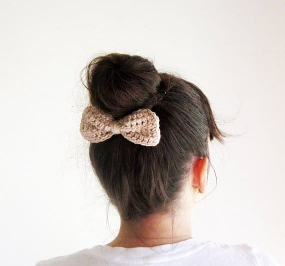 Back view of a woman wearing a crocheted bow.