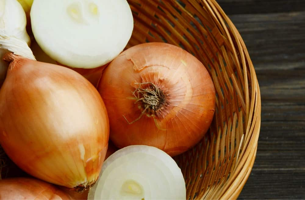 Yellow onions on a basket.