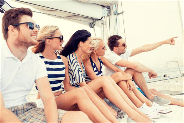 Group of Friends Enjoying on a Sailboat