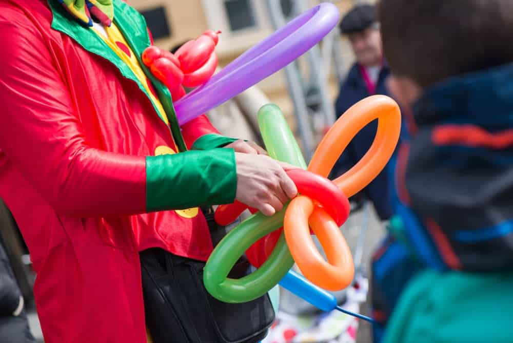 Clown creating balloon animals