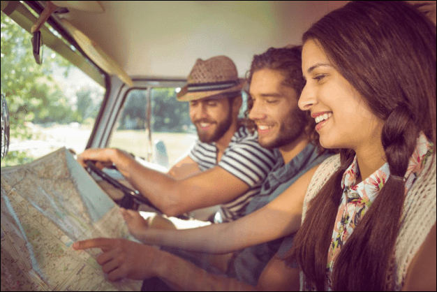 Friends on a Road Trip Looking at a Map