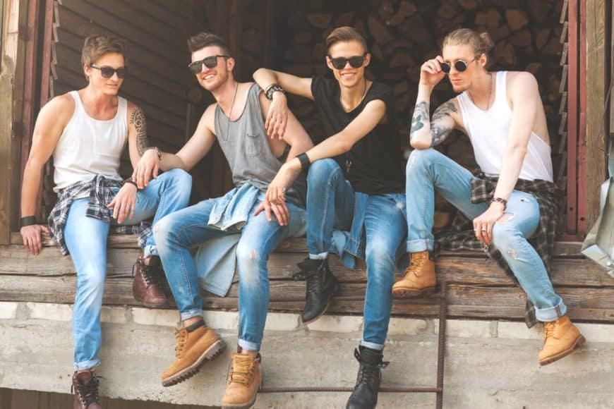 Young individuals wearing trendy jeans