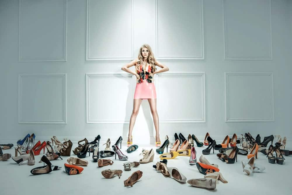 Girl surrounded by shoes