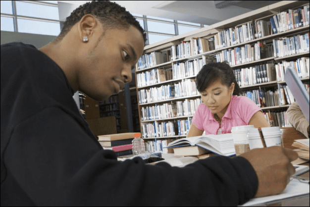 Two Students Studying in a School Library