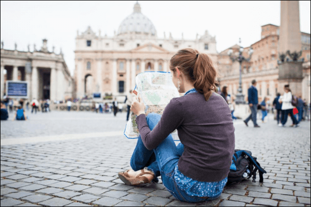 Young Woman Tourist Studying a Map