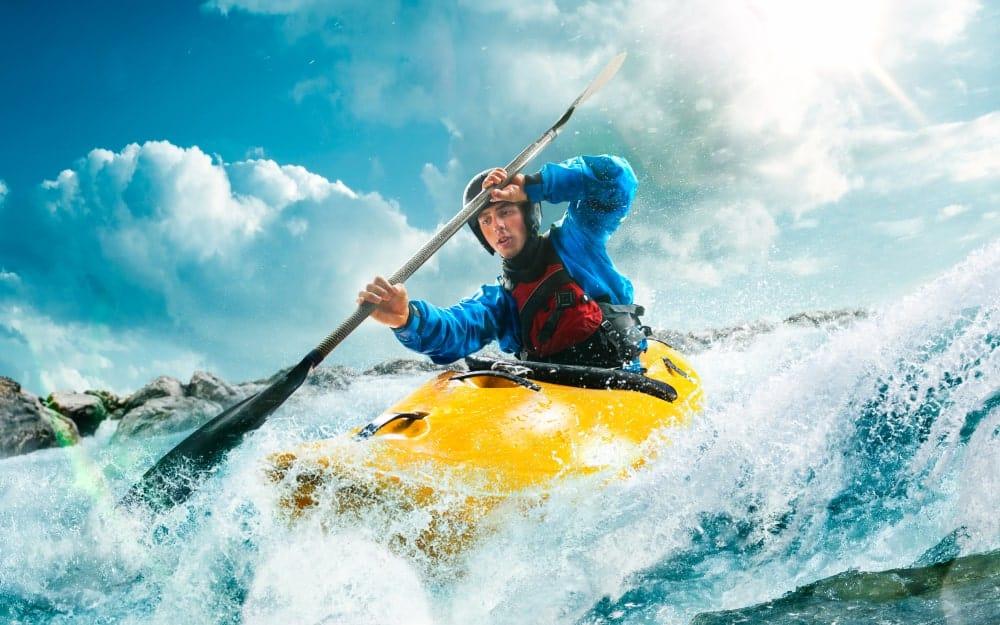 Man canoeing downstream