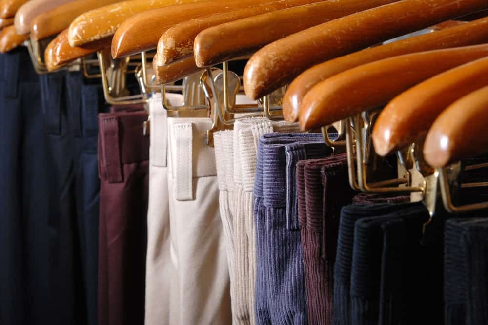 Pants and trousers hanging in hangers
