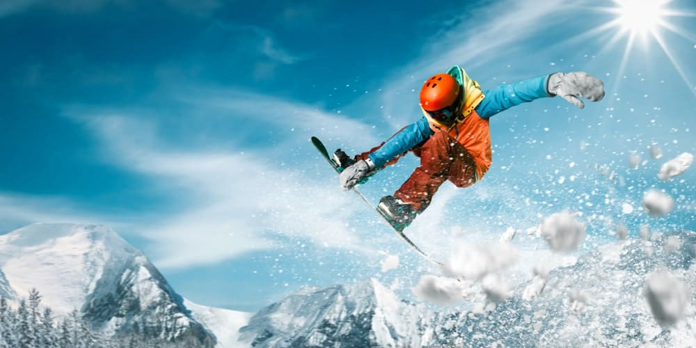 Snowboarder performing a jump